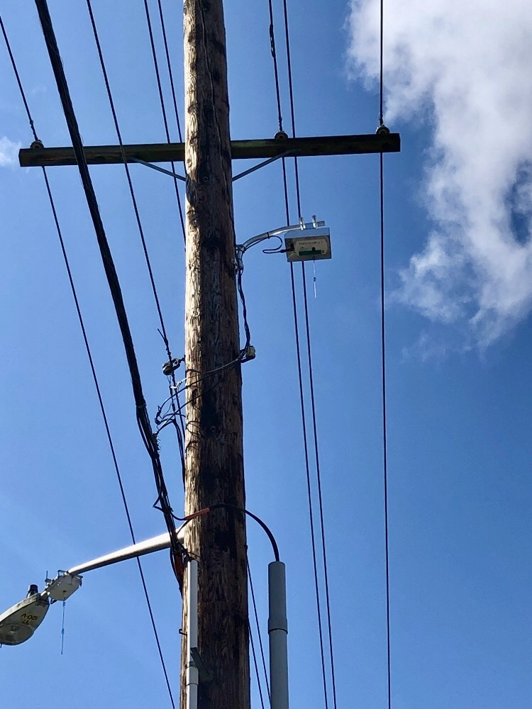 Device attached to utility pole